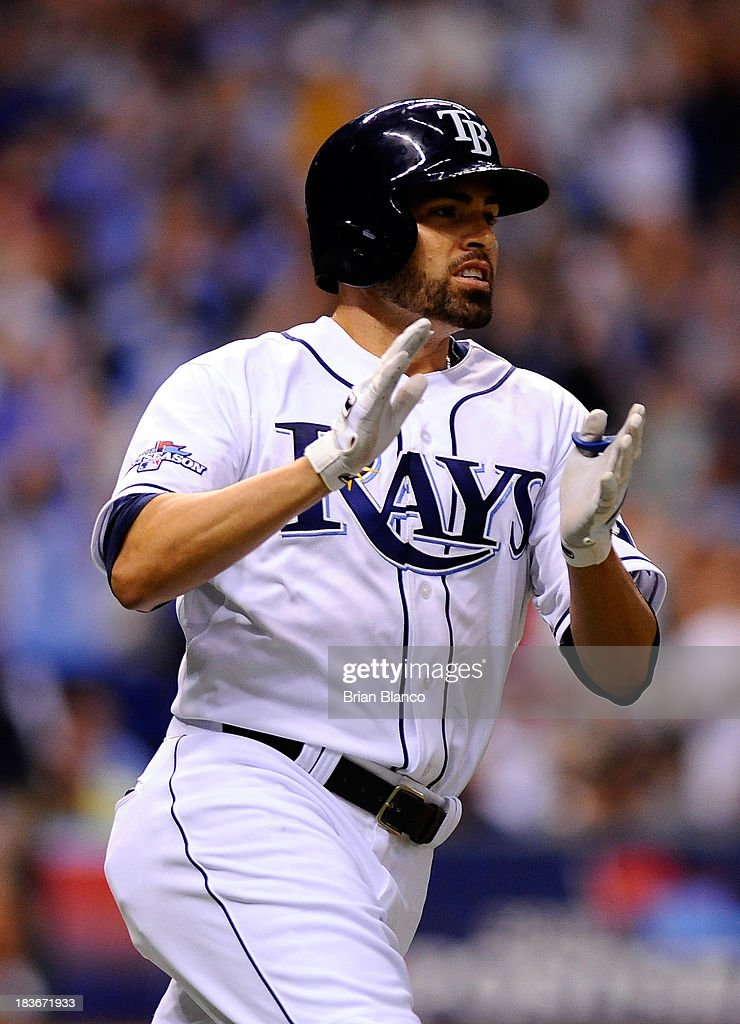 8: David DeJesus #7 of the Tampa Bay Rays celebrates an RBI single in the sixth inning against the Boston Red Sox during Game Four of the American League Division Series at Tropicana Field on October 8, 2013 in St Petersburg, Florida.