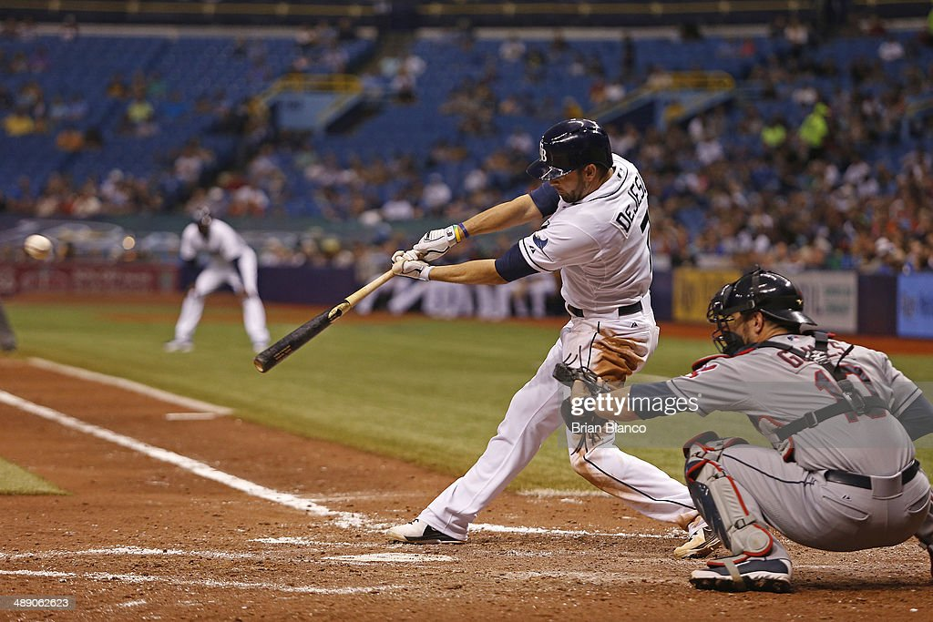 <a gi-track='captionPersonalityLinkClicked' href=/galleries/search?phrase=David+DeJesus&family=editorial&specificpeople=206765 ng-click='$event.stopPropagation()'>David DeJesus</a> #7 of the Tampa Bay Rays hits a double in front of catcher <a gi-track='captionPersonalityLinkClicked' href=/galleries/search?phrase=Yan+Gomes&family=editorial&specificpeople=9004037 ng-click='$event.stopPropagation()'>Yan Gomes</a> #10 of the Cleveland Indians to score teammate Matt Joyce during the fifth inning of a game on May 9, 2014 at Tropicana Field in St. Petersburg, Florida.