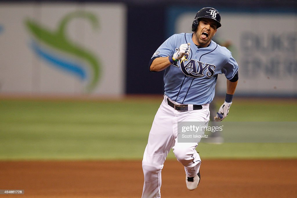 David DeJesus of the Tampa Bay Rays races around the bases as he hit an insidethepark home run against the Baltimore Orioles during the fourth inning...