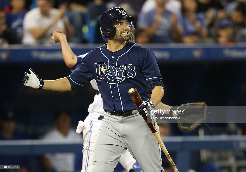 <a gi-track='captionPersonalityLinkClicked' href=/galleries/search?phrase=David+DeJesus&family=editorial&specificpeople=206765 ng-click='$event.stopPropagation()'>David DeJesus</a> #7 of the Tampa Bay Rays reacts after striking out in the ninth inning during MLB game action against the Toronto Blue Jays on September 27, 2013 at Rogers Centre in Toronto, Ontario, Canada.