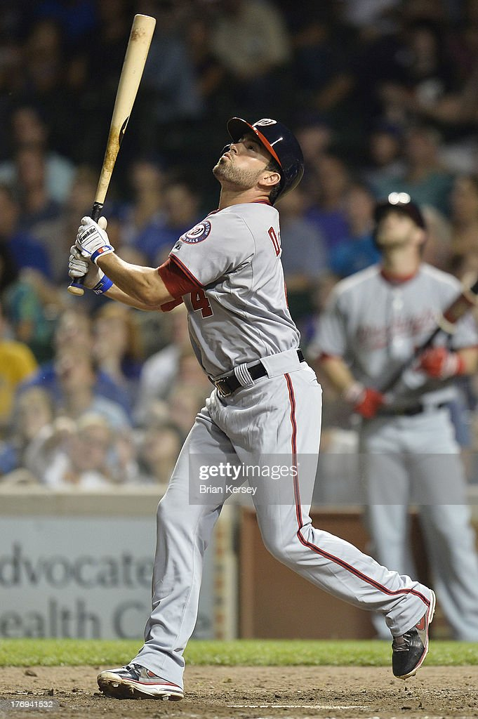 <a gi-track='captionPersonalityLinkClicked' href=/galleries/search?phrase=David+DeJesus&family=editorial&specificpeople=206765 ng-click='$event.stopPropagation()'>David DeJesus</a> #4 of the Washington Nationals pops up during the eighth inning against the Chicago Cubs at Wrigley Field on August 19, 2013 in Chicago, Illinois. DeJesus was traded from the Cubs to the Nationals earlier in the day for a player to be named later.