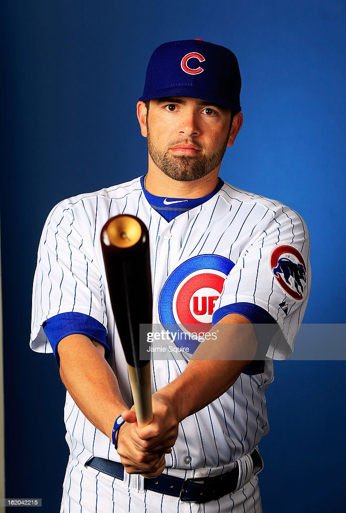 David DeJesus #9 poses during Chicago Cubs photo day on February 18, 2013 at HoHoKam Park in Mesa, Arizona.