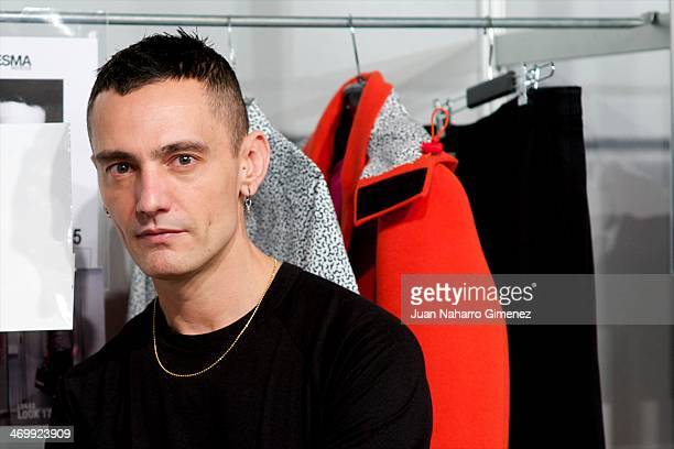 David Delfin prepare backstage before his fashion show during the Mercedes Benz Fashion Week Winter/Fall Madrid 2014 at Ifema on February 17 2014 in...