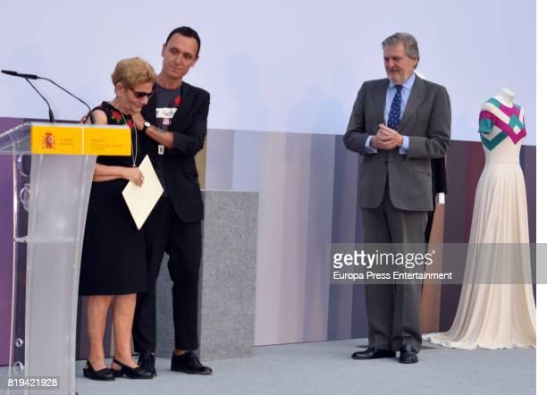David Delfin's mother Maria Gonzalez Corbacho and Gorka Postigo receive the National Fashion Award to David Delfin from the hands of Inigo Mendez de...