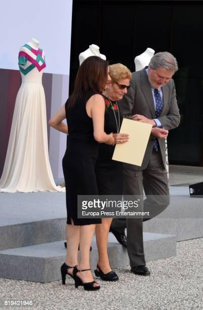 David Delfin's mother Maria Gonzalez Corbacho receives the National Fashion Award to David Delfin from the hands of Inigo Mendez de Vigo The designer...