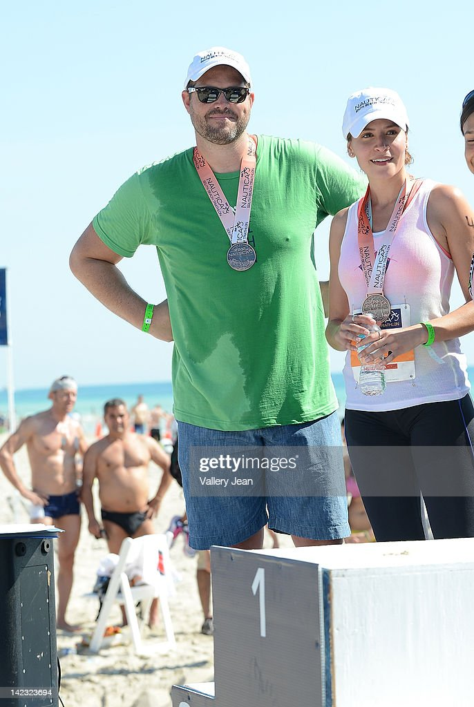 <a gi-track='captionPersonalityLinkClicked' href=/galleries/search?phrase=David+Denman&family=editorial&specificpeople=851215 ng-click='$event.stopPropagation()'>David Denman</a> and <a gi-track='captionPersonalityLinkClicked' href=/galleries/search?phrase=Mercedes+Masohn&family=editorial&specificpeople=7023783 ng-click='$event.stopPropagation()'>Mercedes Masohn</a> participate in the 5th Annual Nautica South Beach Triathlon to benefit St. Jude Children's Research Hospital on April 1, 2012 in Miami Beach, Florida.