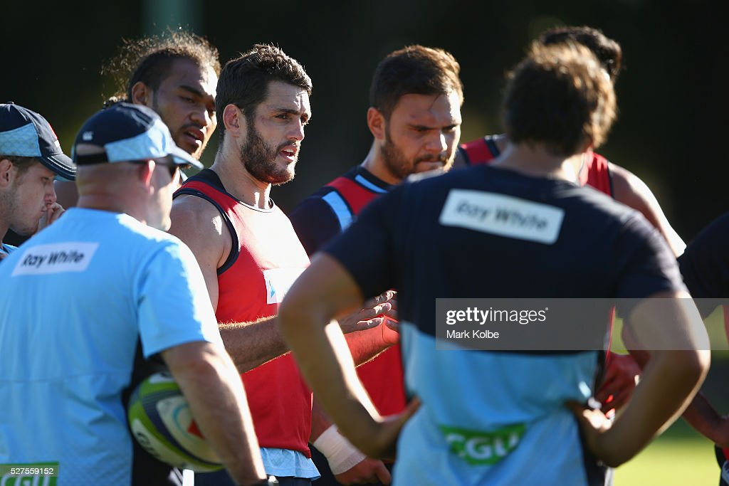 David Dennis gives instructions to a team mate during a Waratahs Super Rugby training session at Kippax Lake on May 3, 2016 in Sydney, Australia.