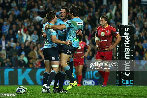 David Dennis of the Waratahs celebrates scoring a try during the round 18 Super Rugby match between the Waratahs and the Reds at Allianz Stadium on...