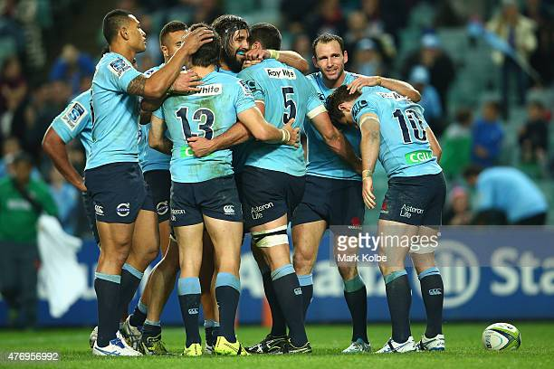 David Dennis of the Waratahs celebrates with his team mates after scoring a try during the round 18 Super Rugby match between the Waratahs and the...
