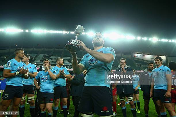 David Dennis of the Waratahs holds the Templeton Cup aloft after winning the round 18 Super Rugby match between the Waratahs and the Reds at Allianz...