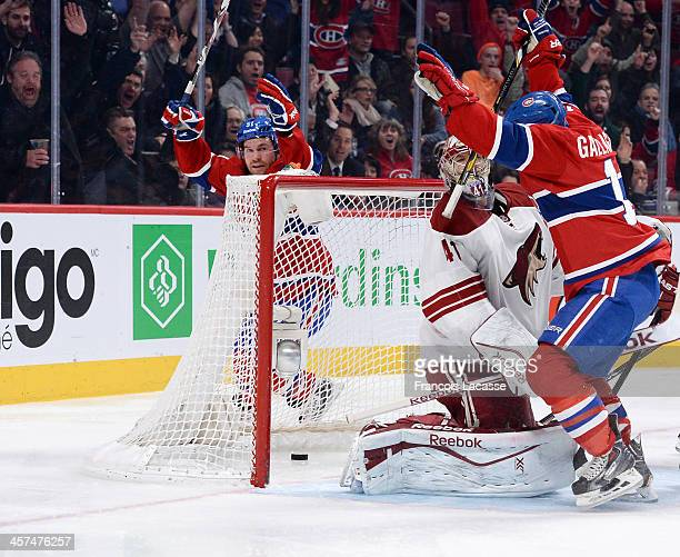 David Desharnais and Brendan Gallagher of the Montreal Canadiens celebrate a goal by Andrei Markov on goaltender Mike Smith of the Phoenix Coyotes...