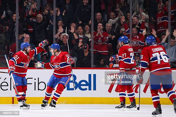 David Desharnais and Dale Weise of the Montreal Canadiens celebrate a goal in the NHL game against the New York Islanders at the Bell Centre on...