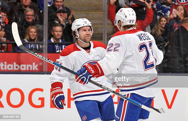 David Desharnais and Dale Weise of the Montreal Canadiens celebrate a first period goal during NHL game action against the Toronto Maple Leafs...
