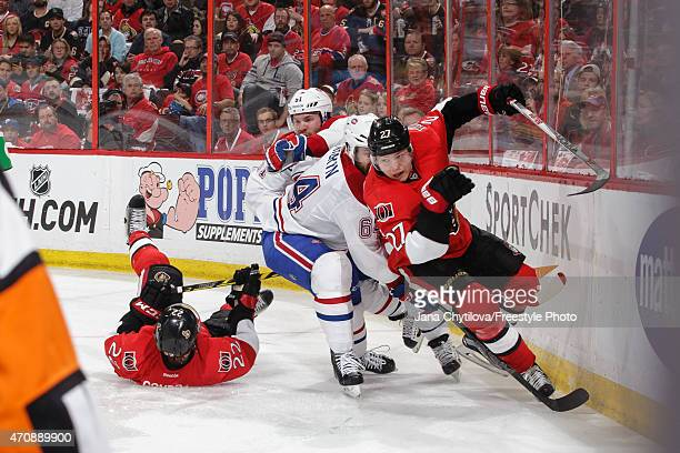 David Desharnais and Greg Pateryn of the Montreal Canadiens defend against Erik Condra and Curtis Lazar of the Ottawa Senators in Game Four of the...