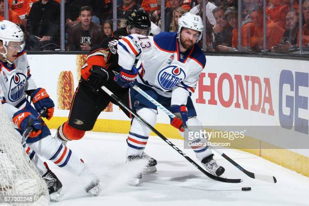 David Desharnais and Matthew Benning of the Edmonton Oilers battle for the puck against Nick Ritchie of the Anaheim Ducks in Game One of the Western...