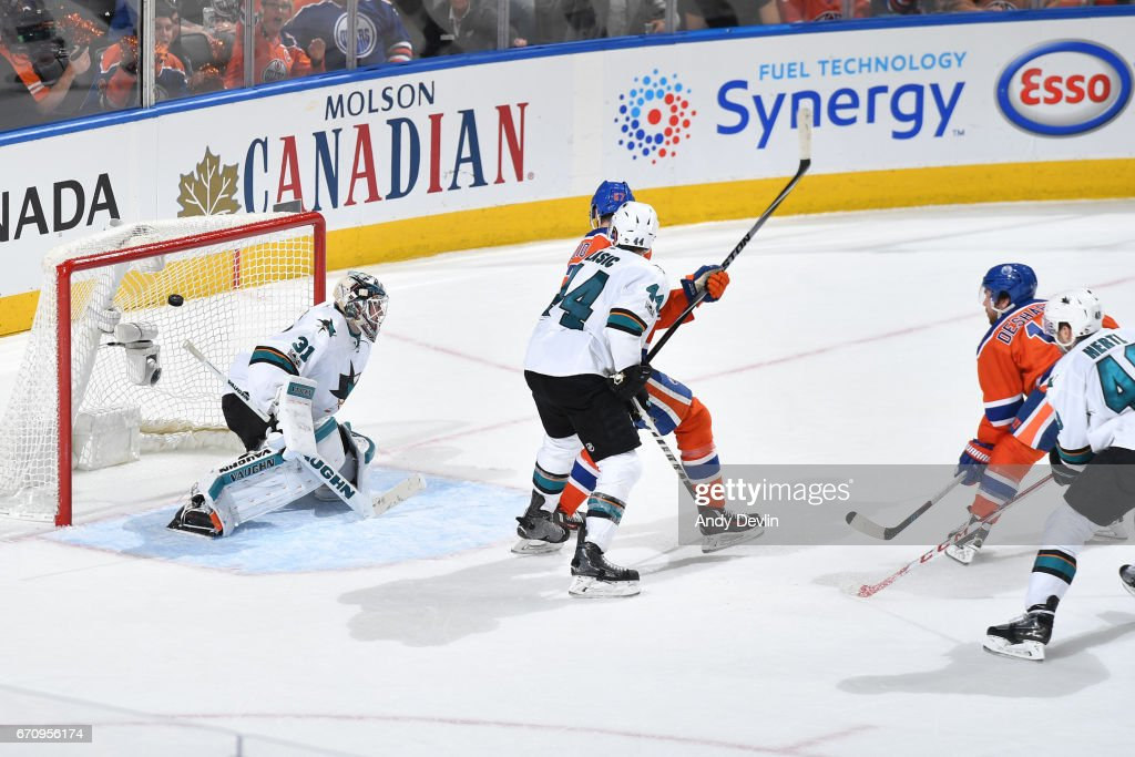 David Desharnais #13 of the Edmonton Oilers scores a goal on Martin Jones #31 of the San Jose Sharks in Game Five of the Western Conference First Round during the 2017 NHL Stanley Cup Playoffs on April 20, 2017 at Rogers Place in Edmonton, Alberta, Canada.