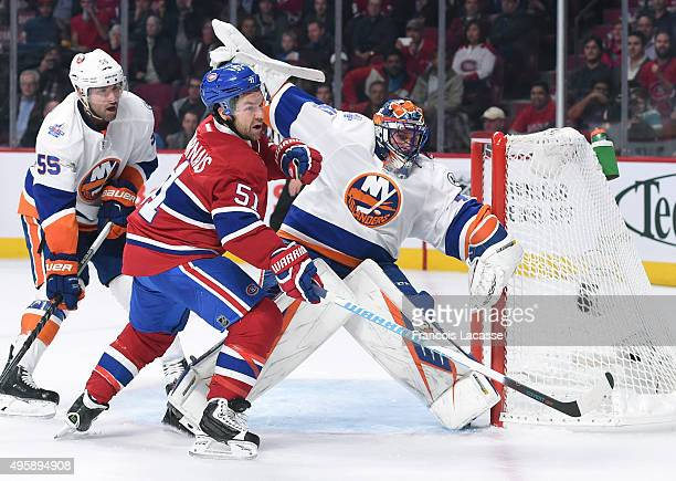 David Desharnais of the Montreal Canadiens and Jaroslav Halak of the New York Islanders during NHL game at the Bell Centre on November 5 2015 in...