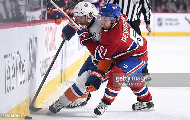 David Desharnais of the Montreal Canadiens and John Tavares of the New York Islanders fight for the puck in the NHL game at the Bell Centre on...