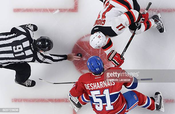 David Desharnais of the Montreal Canadiens and Stephen Gionta of the New Jersey Devils face off in the NHL game at the Bell Centre on January 6 2015...