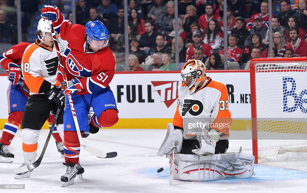 David Desharnais #51 of the Montreal Canadiens attempts to deflect the puck against Brian Boucher #33 of the Philadelphia Flyers during the NHL game on February 16, 2013 at the Bell Centre in Montreal, Quebec, Canada.
