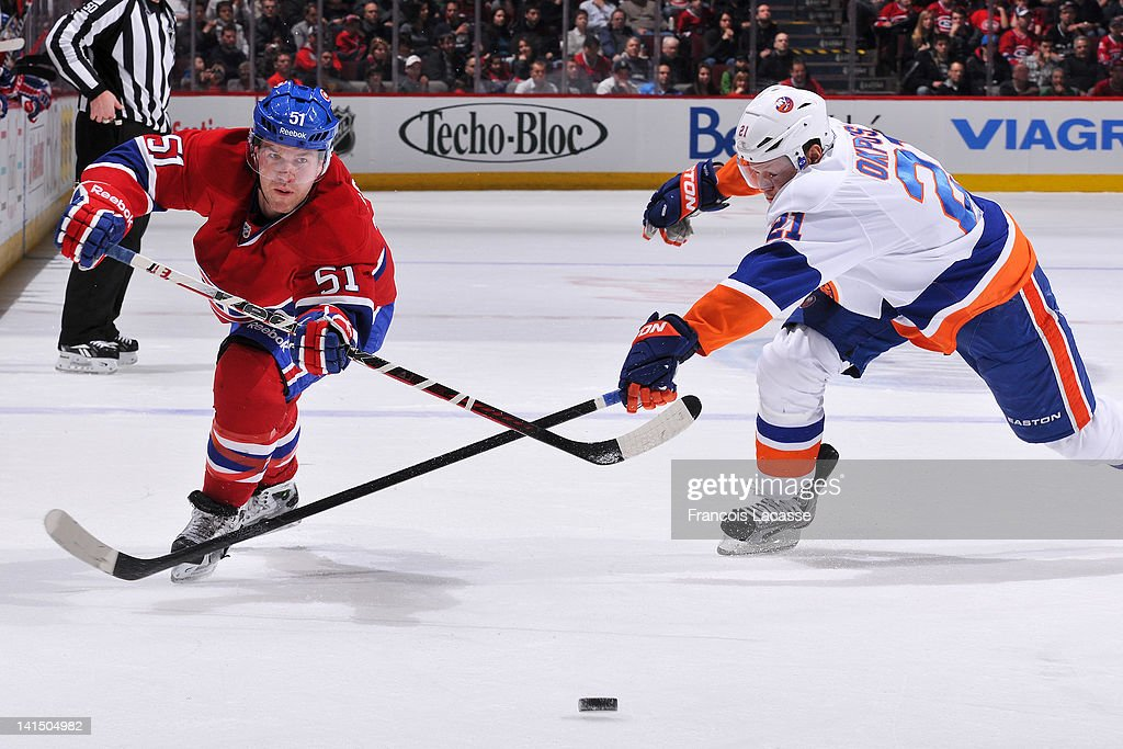 <a gi-track='captionPersonalityLinkClicked' href=/galleries/search?phrase=David+Desharnais&family=editorial&specificpeople=4084305 ng-click='$event.stopPropagation()'>David Desharnais</a> #51 of the Montreal Canadiens attempts to skate past <a gi-track='captionPersonalityLinkClicked' href=/galleries/search?phrase=Kyle+Okposo&family=editorial&specificpeople=540469 ng-click='$event.stopPropagation()'>Kyle Okposo</a> #21 of the New York Islanders during the NHL game on March 17, 2012 at the Bell Centre in Montreal, Quebec, Canada.