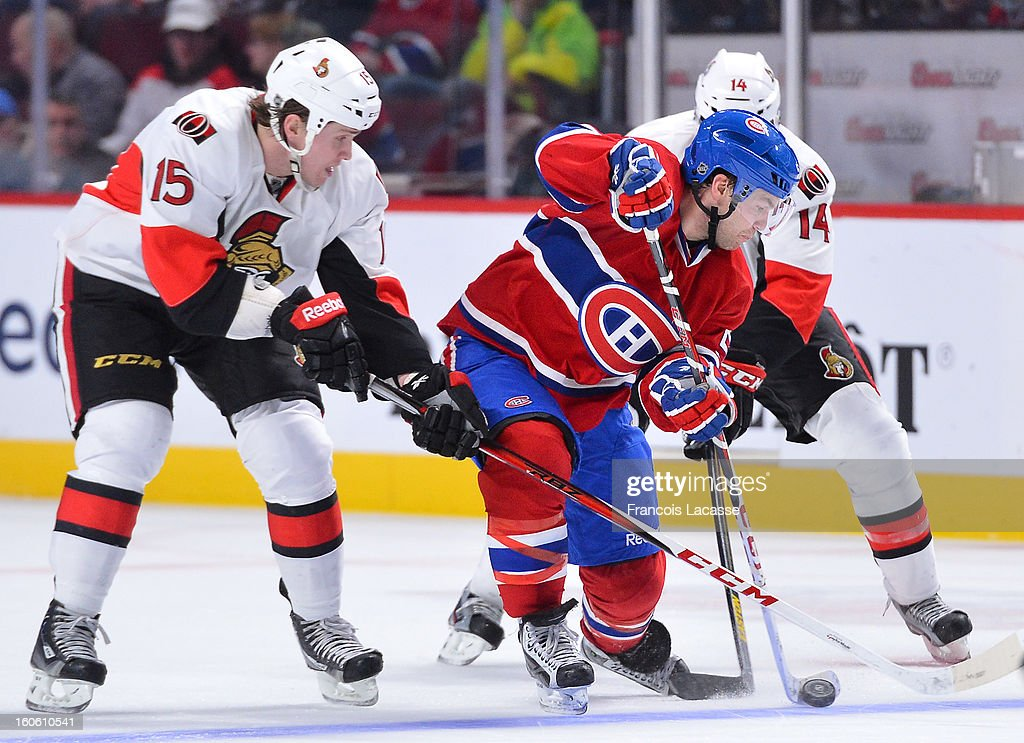 David Desharnais #51 of the Montreal Canadiens battles for the puck with Zack Smith #15 of the Ottawa Senators during the NHL game on February 3, 2013 at the Bell Centre in Montreal, Quebec, Canada.