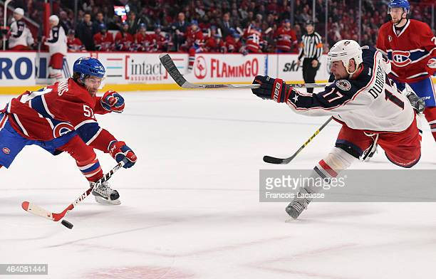 David Desharnais of the Montreal Canadiens blocks the shot of Brandon Dubinsky of the Columbus Blue Jackets in the NHL game at the Bell Centre on...