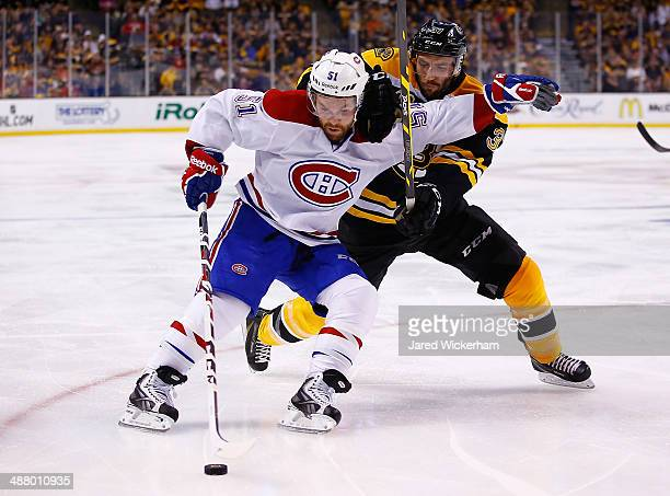 David Desharnais of the Montreal Canadiens carries the puck into the corner past Patrice Bergeron of the Boston Bruins in the second period in Game...