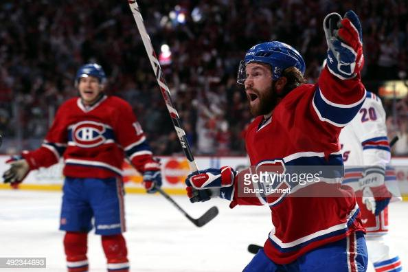 David Desharnais of the Montreal Canadiens celebrates a goal scored by teammate Max Pacioretty against Henrik Lundqvist of the New York Rangers...