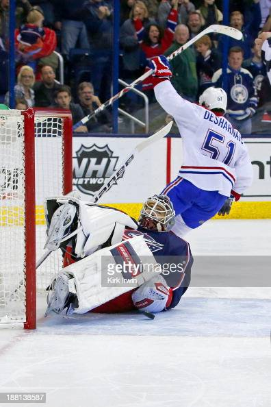 David Desharnais of the Montreal Canadiens celebrates after scoring the gamewinning goal against Curtis McElhinney of the Columbus Blue Jackets in...