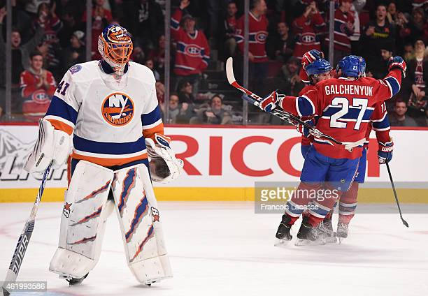 David Desharnais of the Montreal Canadiens celebrates with Alex Galchenyuk and Brendan Gallagher after scoring a goal against the New York Islanders...