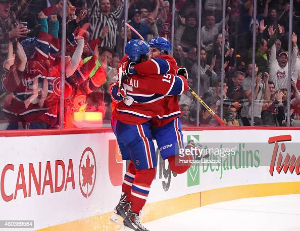 David Desharnais of the Montreal Canadiens celebrates with PierreAlexandre Parenteau after scoring a goal against the Los Angeles Kings in the NHL...