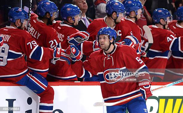 David Desharnais of the Montreal Canadiens celebrates with the bench after scoring a goal against the Winnipeg Jets in the NHL game at the Bell...