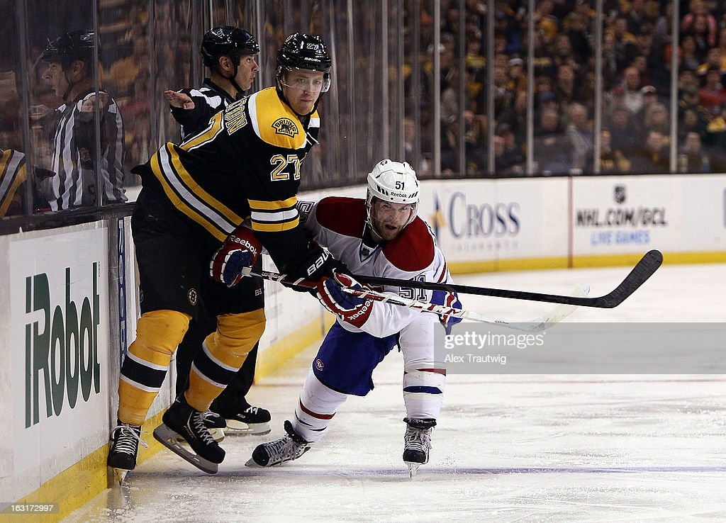 David Desharnais #51 of the Montreal Canadiens checks Dougie Hamilton #27 of the Boston Bruins during a game at the TD Garden on March 3, 2013 in Boston, Massachusetts.