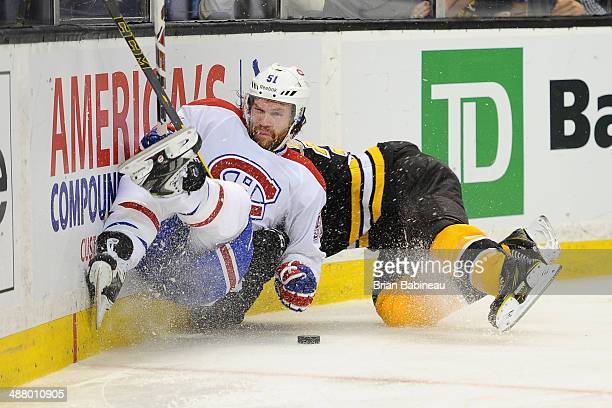 David Desharnais of the Montreal Canadiens collides with Patrice Bergeron of the Boston Bruins in Game Two of the Second Round of the 2014 Stanley...