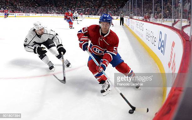 David Desharnais of the Montreal Canadiens controls the puck against Jamie Mcbain of the Los Angeles Kings in the NHL game at the Bell Centre on...
