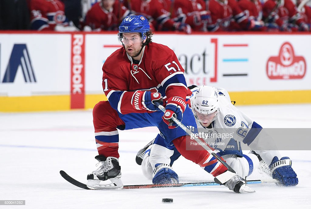 David Desharnais of the Montreal Canadiens controls the puck while being challenged by Andrej Sustr of the Tampa Bay Lightning in the NHL game at the...