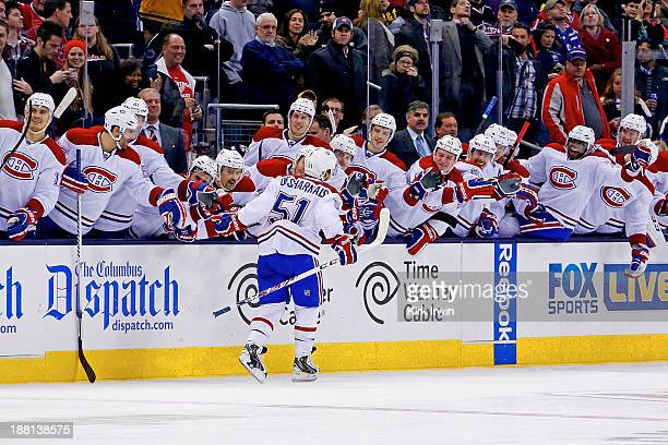 David Desharnais of the Montreal Canadiens is congratulated by his teammates after scoring the gamewinning goal in a shootout to defeat the Columbus...