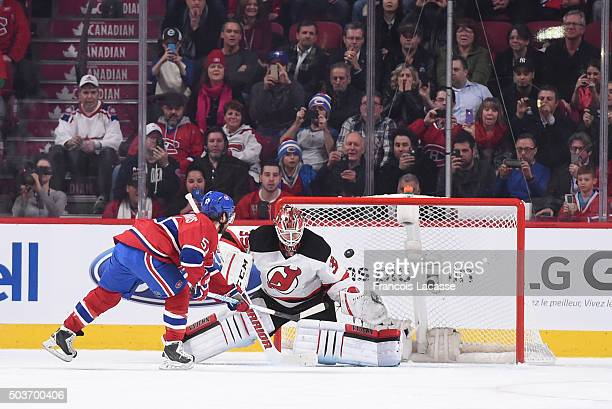 David Desharnais of the Montreal Canadiens misses the net against Cory Schneider of the New Jersey Devils in the NHL game at the Bell Centre on...