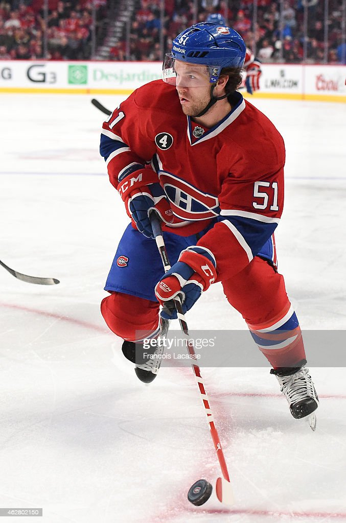 David Desharnais of the Montreal Canadiens passes the puck against the Phoenix Coyotes in the NHL game at the Bell Centre on February 1 2015 in...