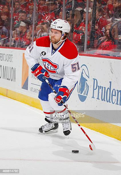 David Desharnais of the Montreal Canadiens plays the puck against the New Jersey Devils during the game at the Prudential Center on April 3 2015 in...