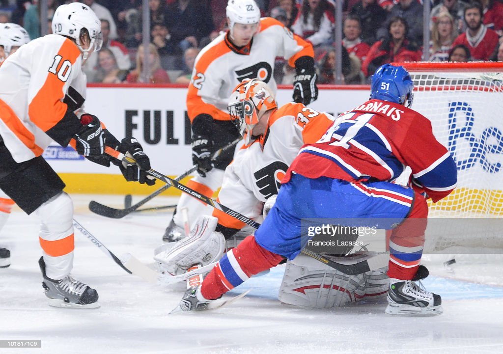 David Desharnais of the Montreal Canadiens scores a goal against goaltender Brian Boucher of the Philadelphia Flyers during the NHL game on February...