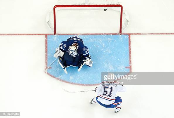 David Desharnais of the Montreal Canadiens scores in overtime against Anders Lindback of the Tampa Bay Lightning during the game at the Tampa Bay...