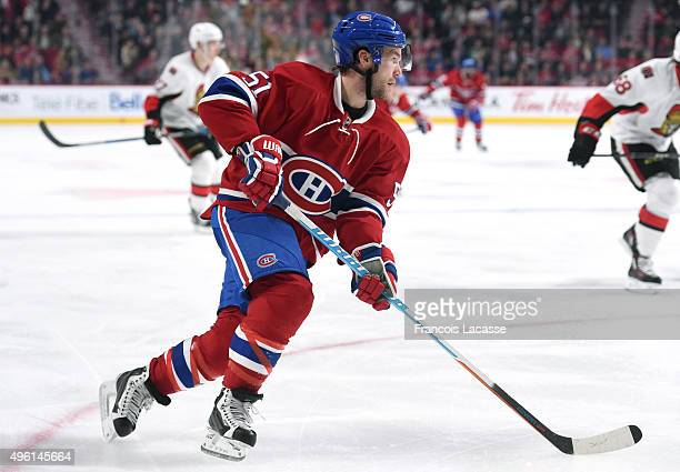 David Desharnais of the Montreal Canadiens skates with the puck against the Ottawa Senators in the NHL game at the Bell Centre on November 3 2015 in...