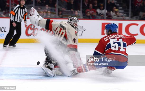 David Desharnais of the Montreal Canadiens takes a shot in the first period against Robin Lehner of the Ottawa Senators during the NHL game on March...