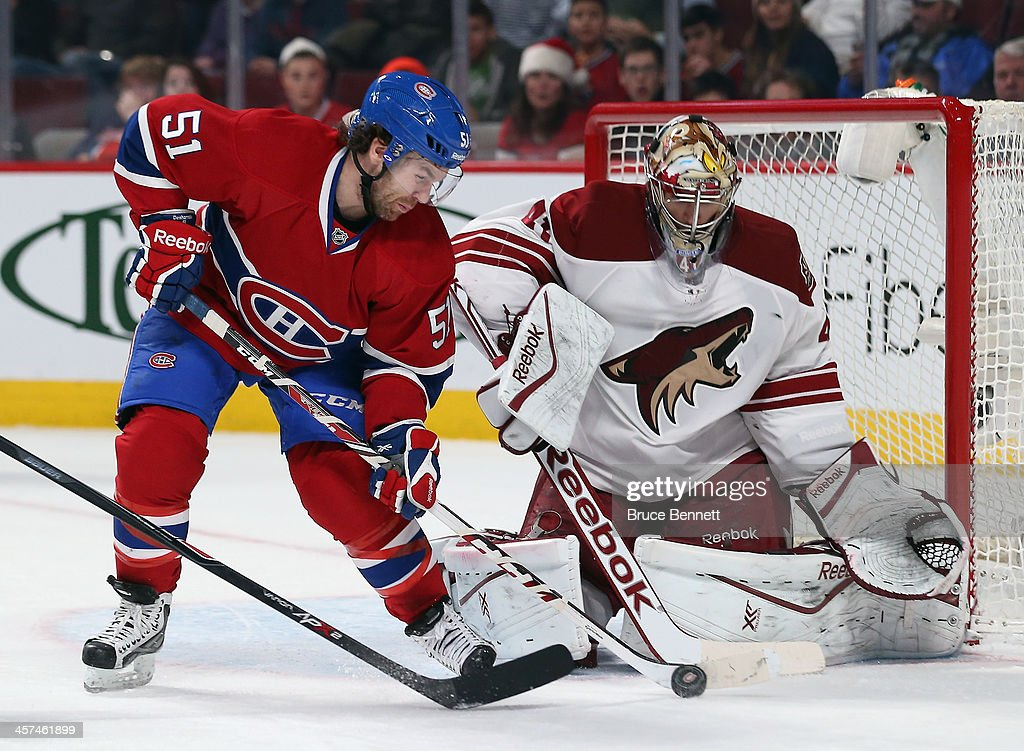 David Desharnais of the Montreal Canadiens tries to deflect a shot past Mike Smith of the Phoenix Coyotes during the second period at the Bell Centre...
