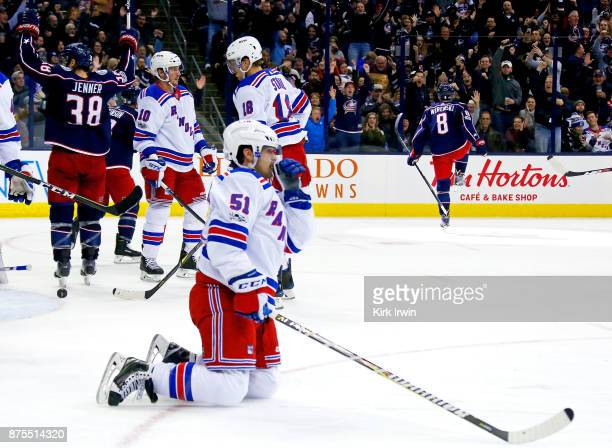 David Desharnais of the New York Rangers reacts to his team giving up a goal as Boone Jenner of the Columbus Blue Jackets and Zach Werenski of the...