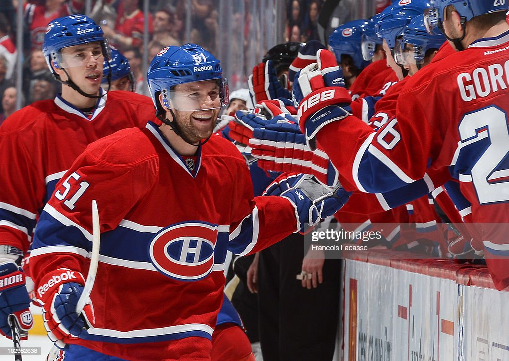David Desharnais #51 skates past the Montreal Canadiens bench following a goal against the Pittsburgh Penguins during the NHL game on March 2, 2013 at the Bell Centre in Montreal, Quebec, Canada.