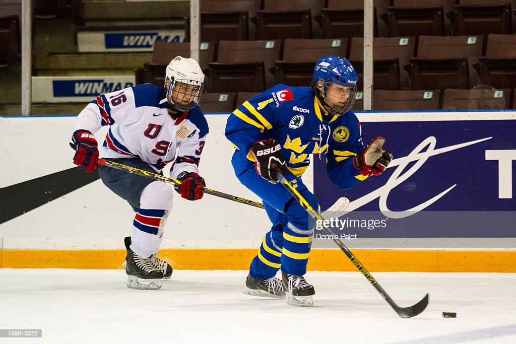David Deutsch #4 of Sweden moves the puck against Nick Pastujov #36 of the United States during semifinals at the World Under-17 Hockey Challenge on November 7, 2014 at the RBC Centre in Sarnia, Ontario.