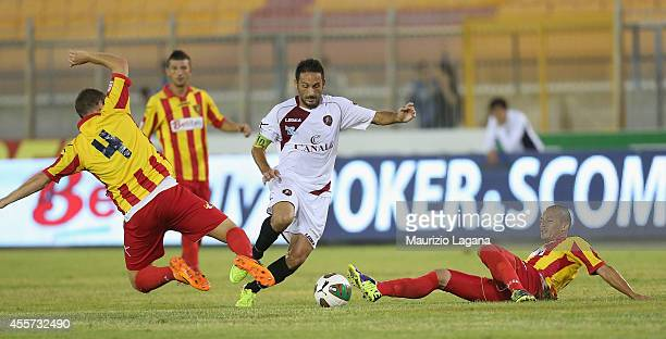 David Di Michele of Reggina competes for the ball with Romeo Papini and Gulliermo Martinez of Lecce during the Lega Pro match between US Lecce and...